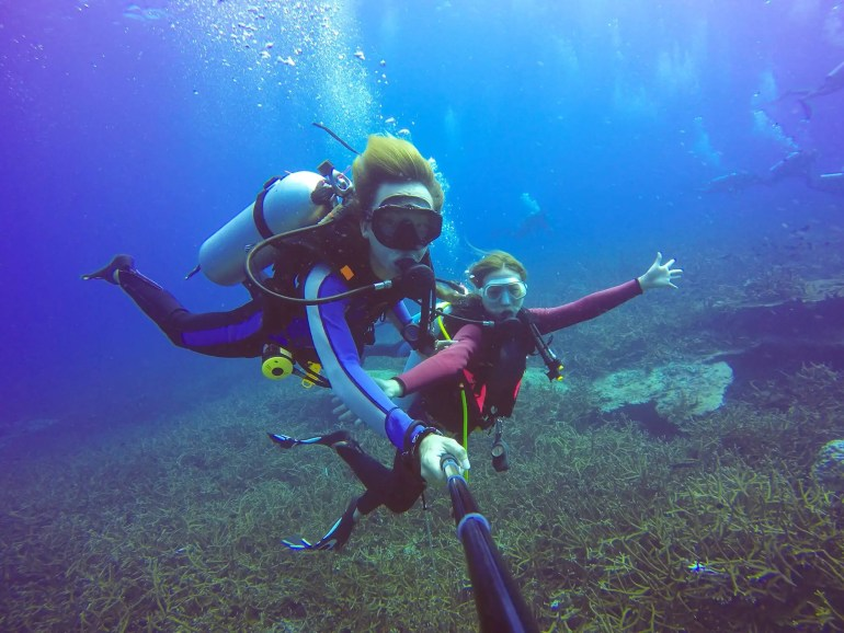 mother and daughter scuba diving in Maui
