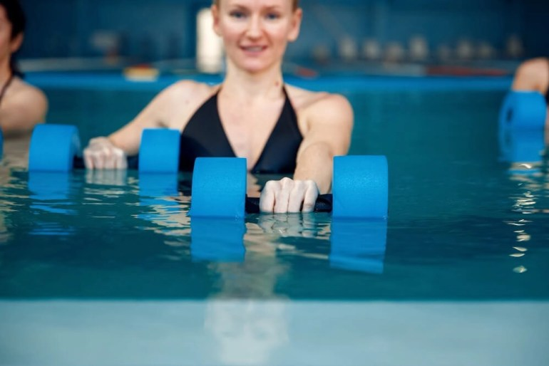 water aerobics with dumbbells