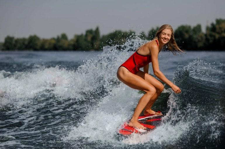 woman riding wakesurf board