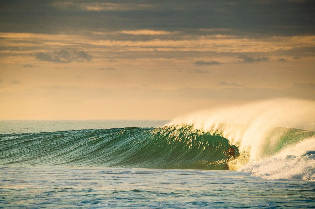 """This photo of Cliff Kapono originally appeared in our style issue, in the feature titled """"Of Perfect Waves and Their Keepers"""". Kapono traveled to a certain under-wraps wave and talked to locals about the area's future, which is on the brink of development."""