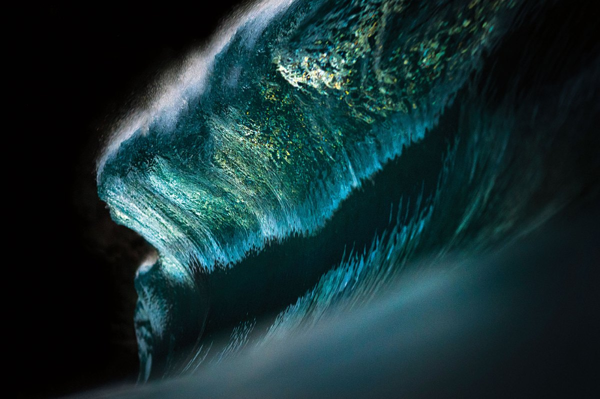 """Ray Collins is a coal-miner-turned-photographer and has become known over the past decade for bringing new angles to oceanic imagery. This shot was featured in a breathtaking photo gallery titled """"Ocean Abstracts"""", which you can view and gawk at here."""