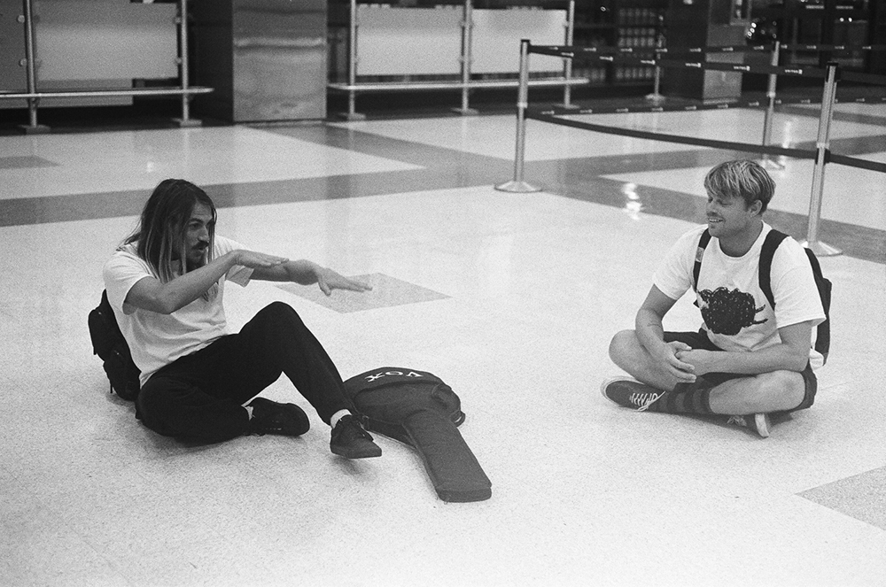 Dylan Graves and Dane Reynolds, getting psyched in the airport before a flight to Panama a few years back, before linoleum floors were a potentially COVID-carrying surface.