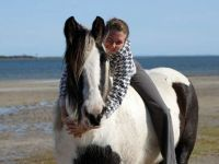 Australia's first Gypsy Cob mare Tia pictured on the beach with Melinda Phillips