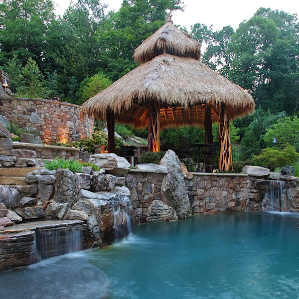 thatched roof tiki bar swimming