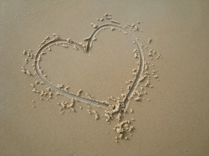 heart in beach sand on What God Thinks When You're Not Feeling Good Enough