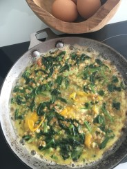 making a frittata with wild garlic and farro