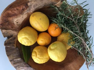 Freshly picked lemons and oranges.