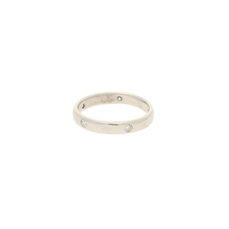 An 18ct white gold band set with five brilliant cut diamonds