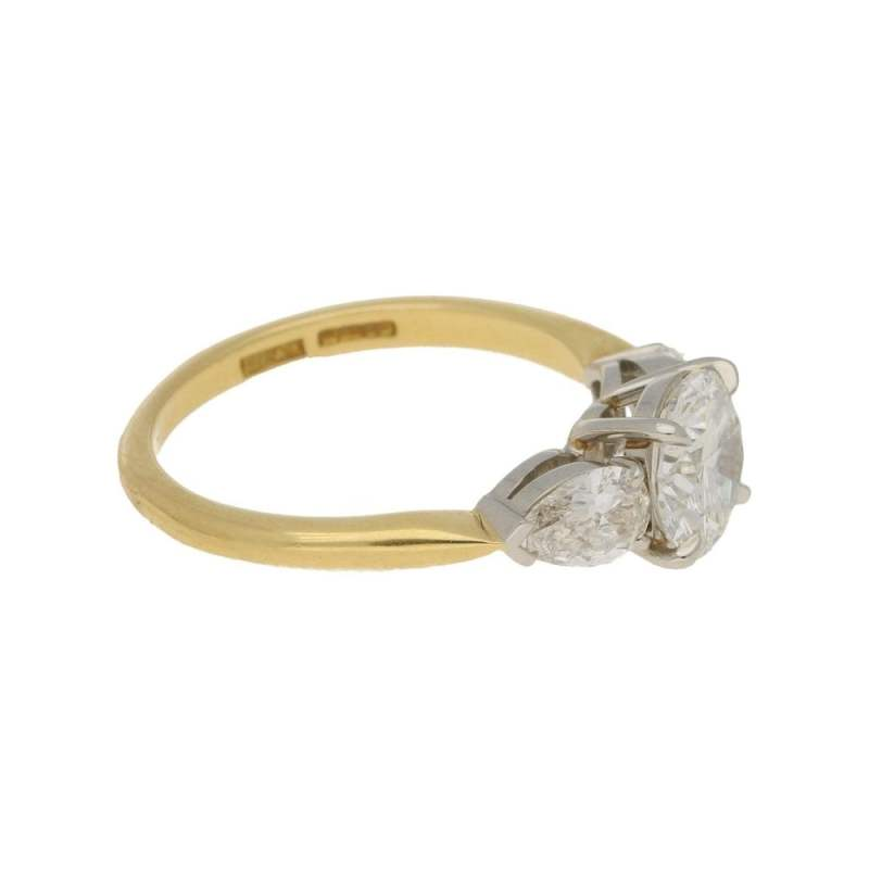 Diamond engagement ring with pear shoulders
