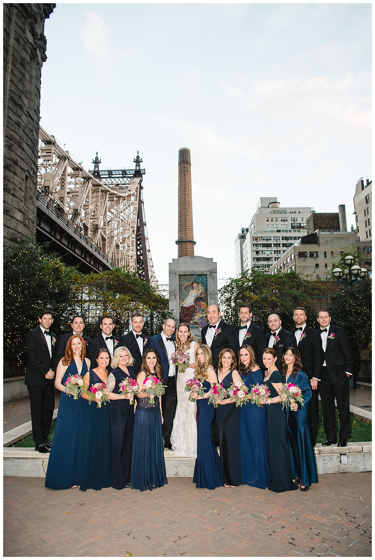 A portrait session of a bride and a groom with their wedding parties on a wedding day at Guastavinos in New York City. Dress by Ines Di Santo.
