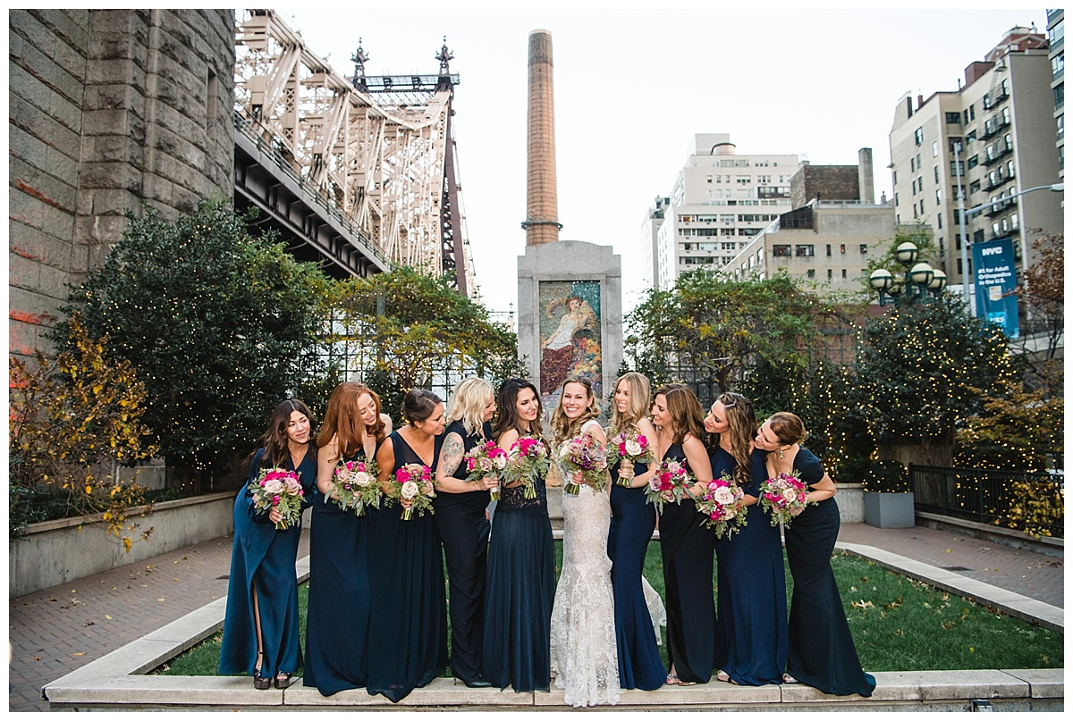 A portrait session of a bride with her bridesmaids on a wedding day at Guastavinos in New York City. Dress by Ines Di Santo.