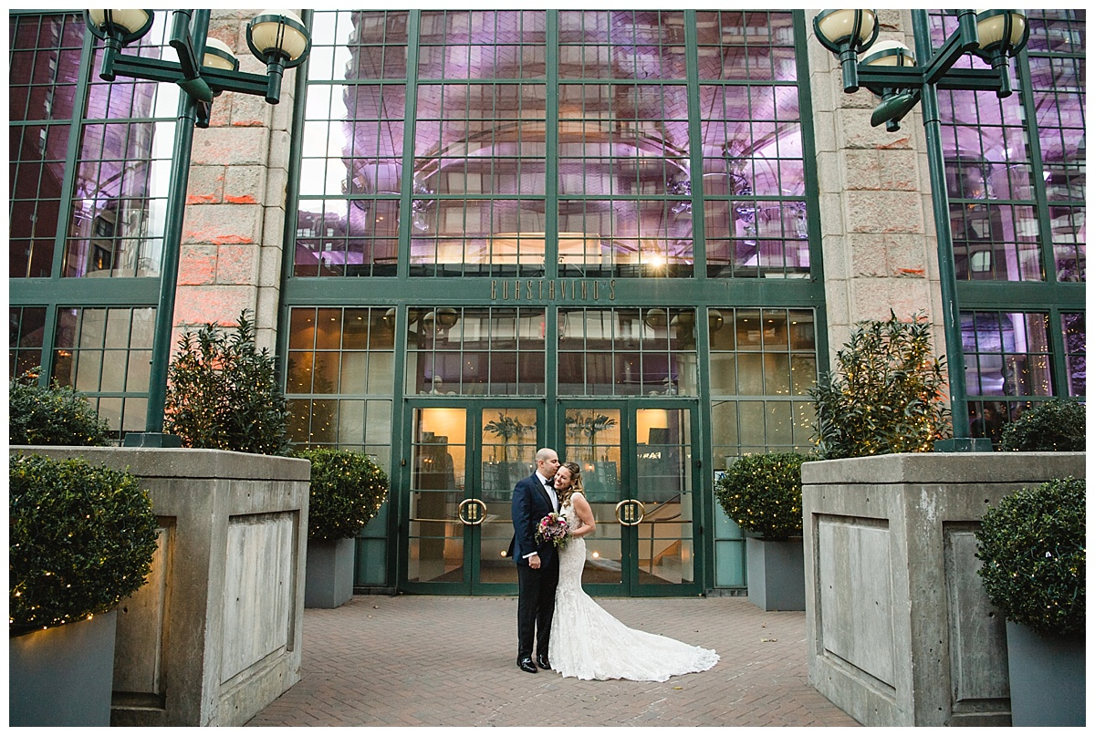 A portrait session of a bride and a groom on a wedding day at Guastavinos in New York City. Dress by Ines Di Santo.