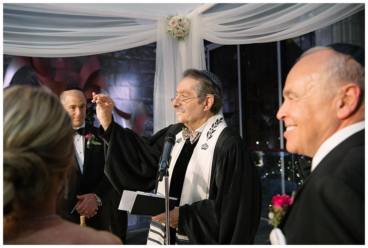 An officiant proceeding a jewish wedding ceremony at Guastavinos in New York City.