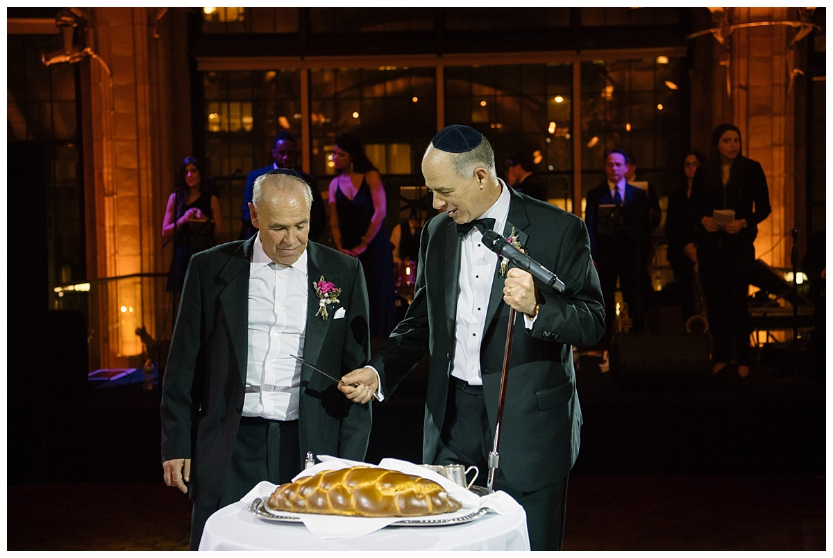 A blessing of a challah bread during a wedding reception at Guastavinos in New York City.
