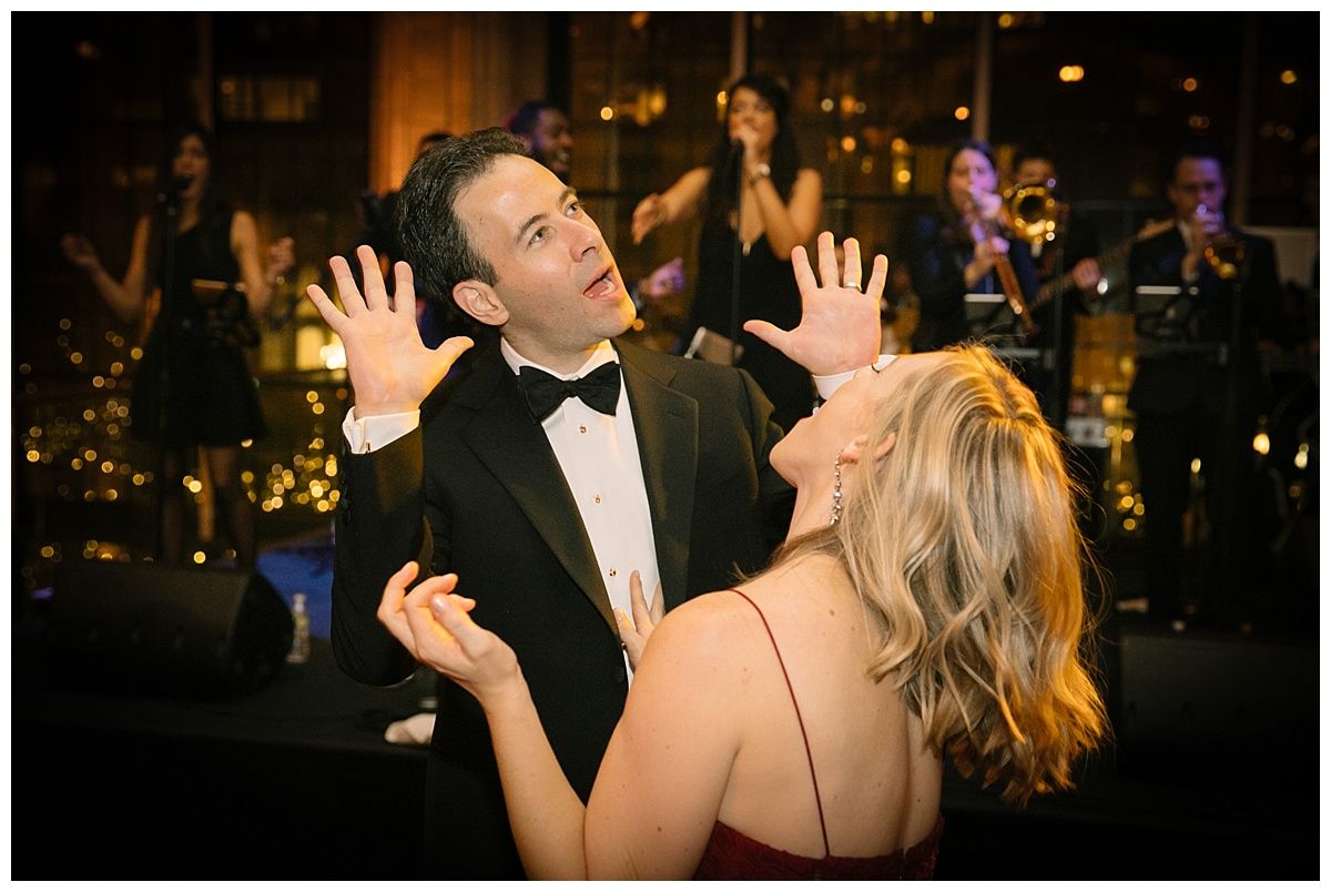 Wedding guests dancing to a music by Storytellers during a wedding reception at Guastavinos in New York City.