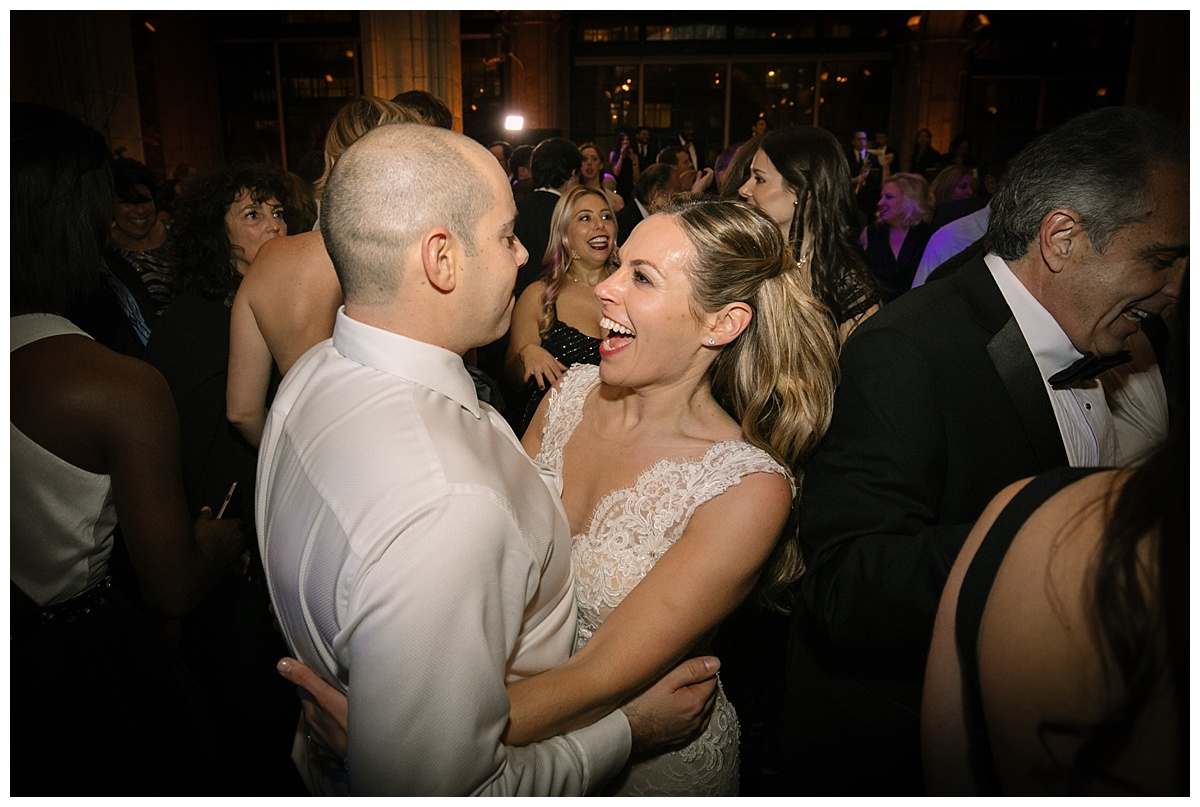 A newly wedded couple dancing together during a wedding reception at Guastavinos in New York City. Dress by Ines Di Santo.