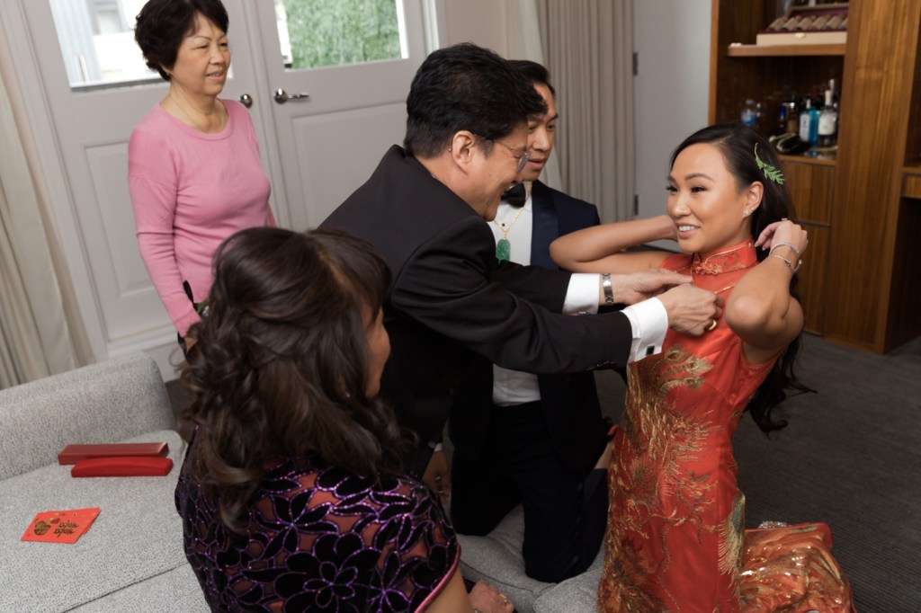 A bride and groom's tea ceremony in Mr. C Seaport Hotel on a wedding day at Cipriani Wall Street in New York City.