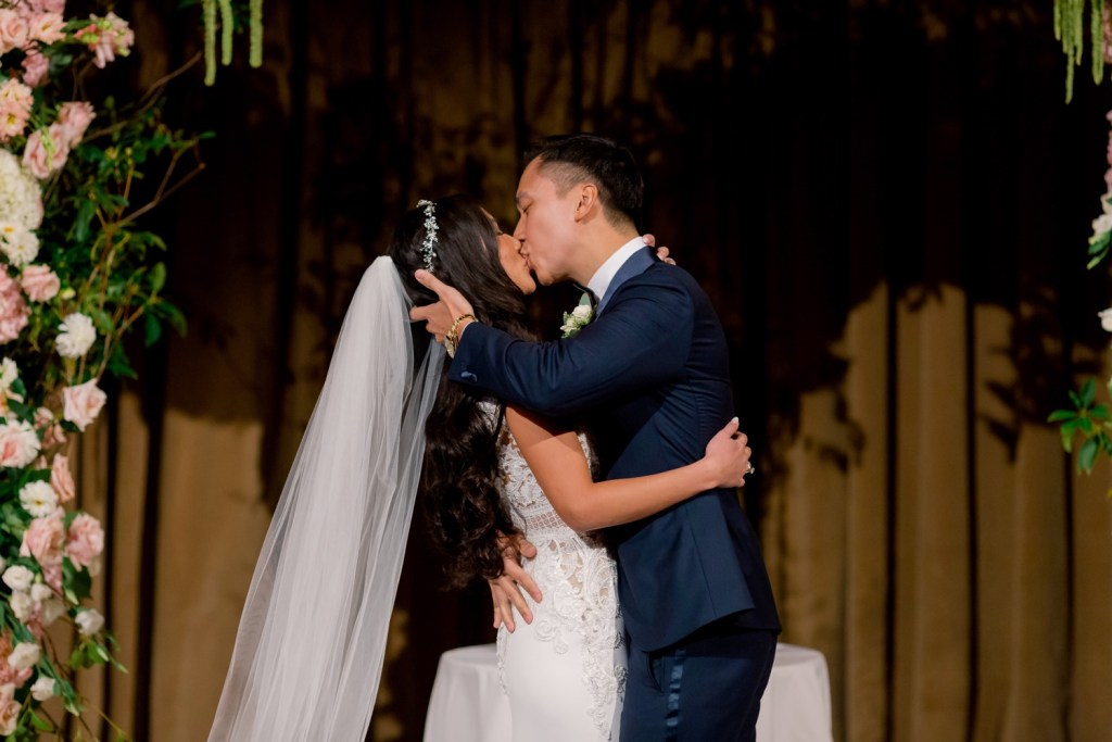A first kiss as a husband and wife during a wedding ceremony at Cipriani Wall Street in New York City.