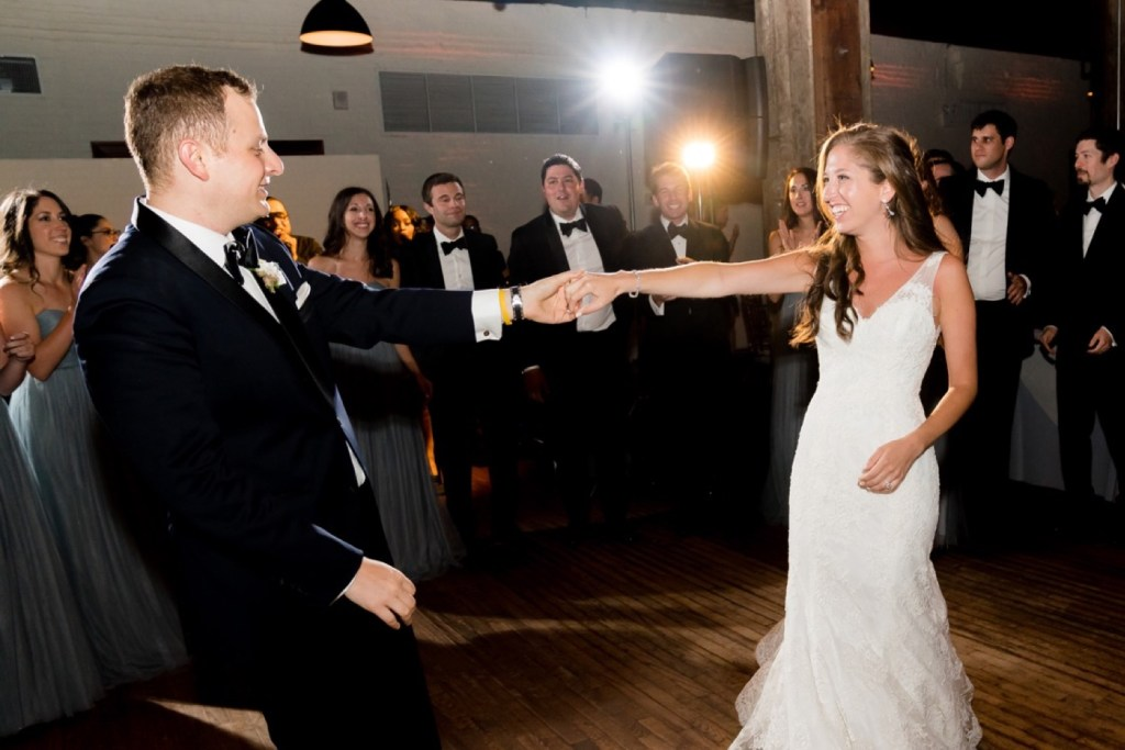 A newly wedded couple's first dance during a wedding reception at Liberty Warehouse, Brooklyn New York.