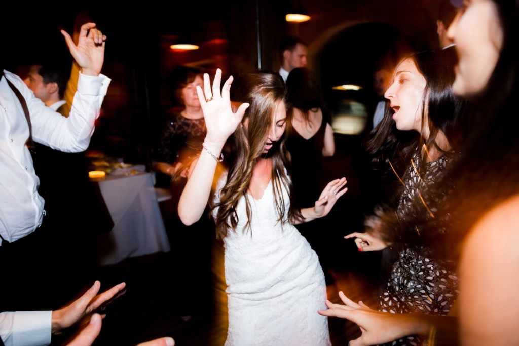 A newly wedded bride dancing together during a wedding reception at Liberty Warehouse, Brooklyn New York.