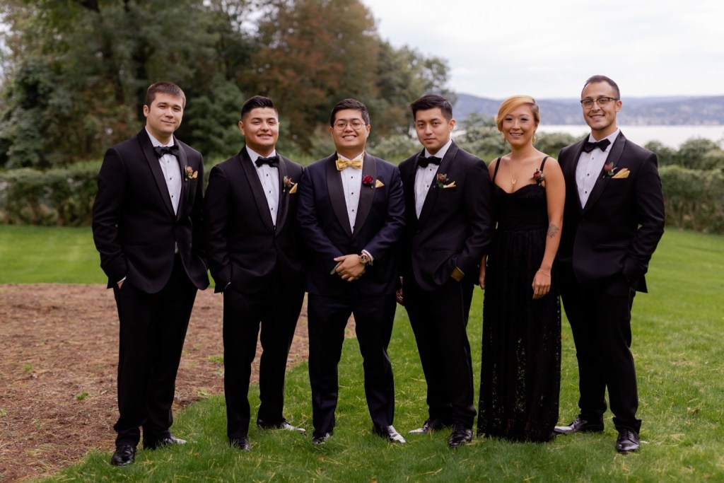 A groom and his groomsmen posing for a picture at the Tappan Hill Mansion.
