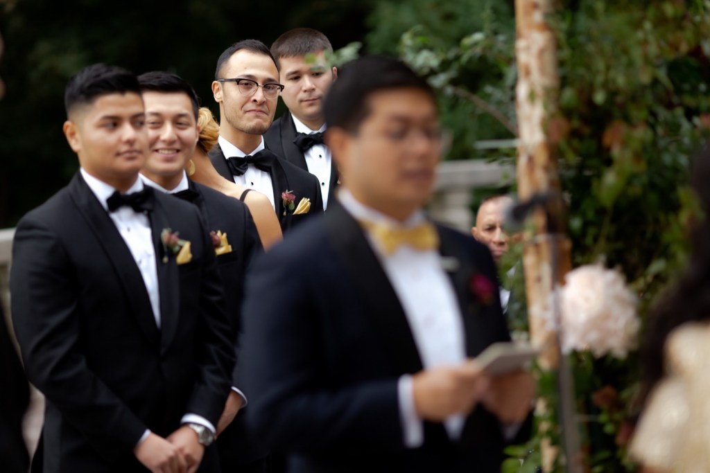 Groomsmen listening to their groom's wedding vow during a wedding ceremony at the Tappan Hill Mansion.
