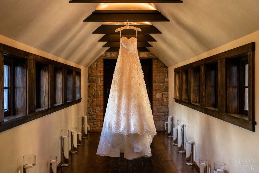 closer photo of wedding dress hanging at blue hill stone barns