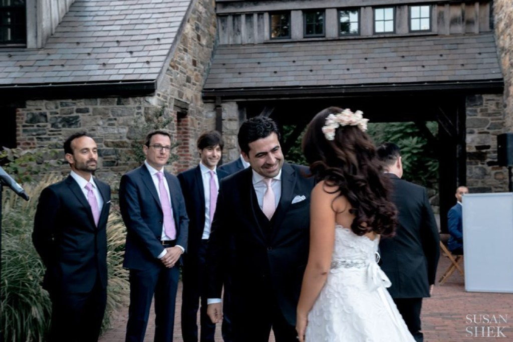 groom receives his bride at blue hill stone barns