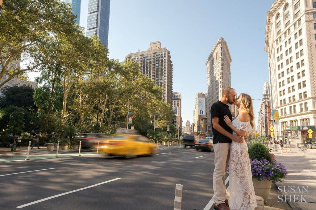 Couple kissing in Flatiron by Eataly and Shake Shack