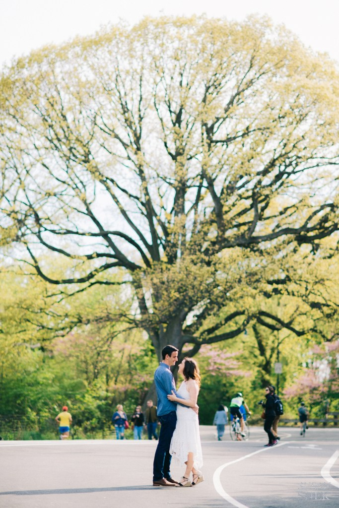 Standing by the big tree inside Prospect Park for engagement photos