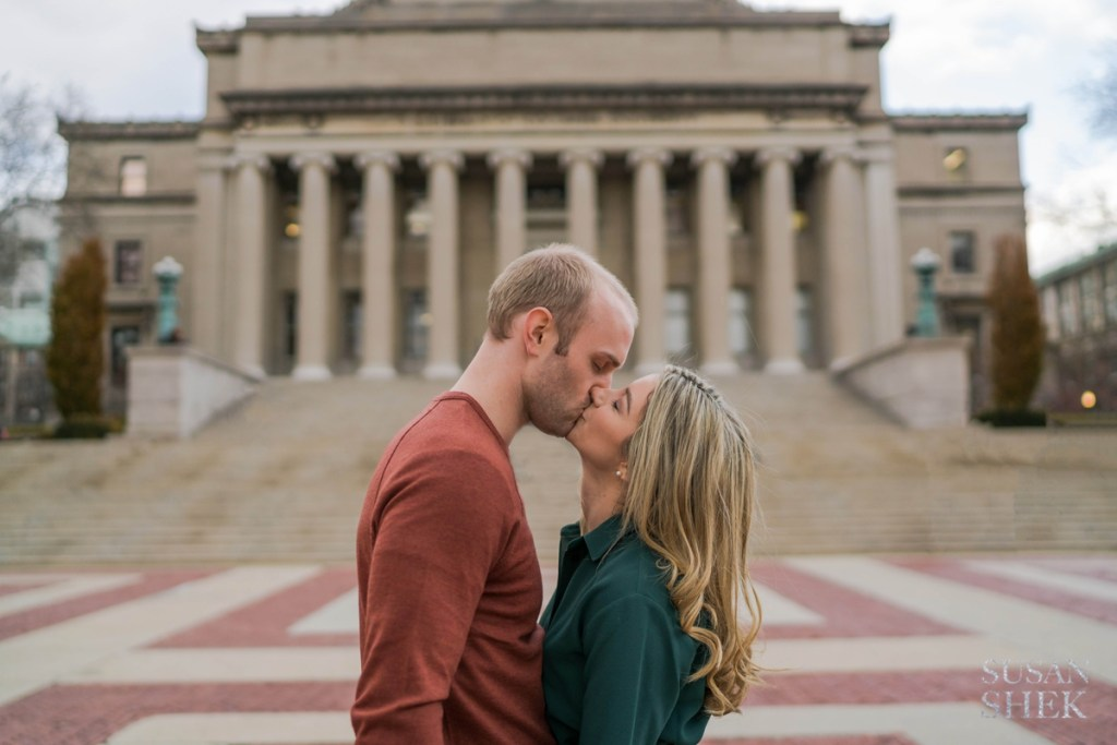 a photo of a couple kissing in front of Columbia University