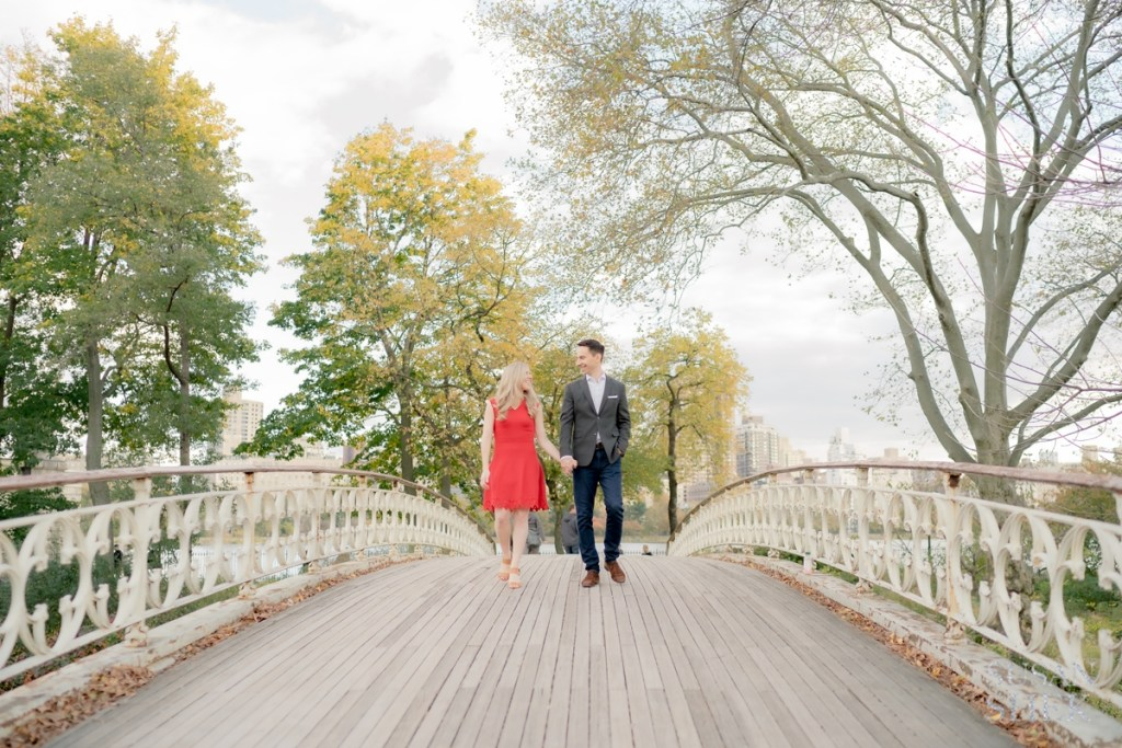 an engagement photoshoot at gothic bridge in a beautiful autumn day