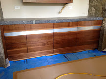 Walnut cabinets with live edge zinc inlay