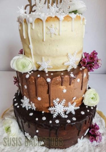 Winterliche Schokoladen Drip Cake Hochzeitstorte Mit Schneeflocken