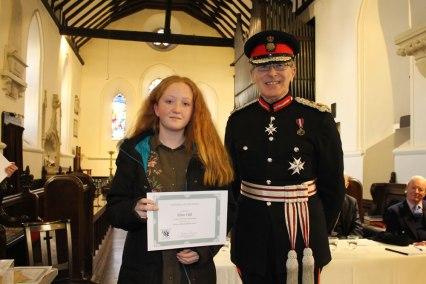 Ellen Hill one of the under 16 competitors receiving her certificate