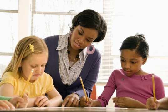 Children writing in schools