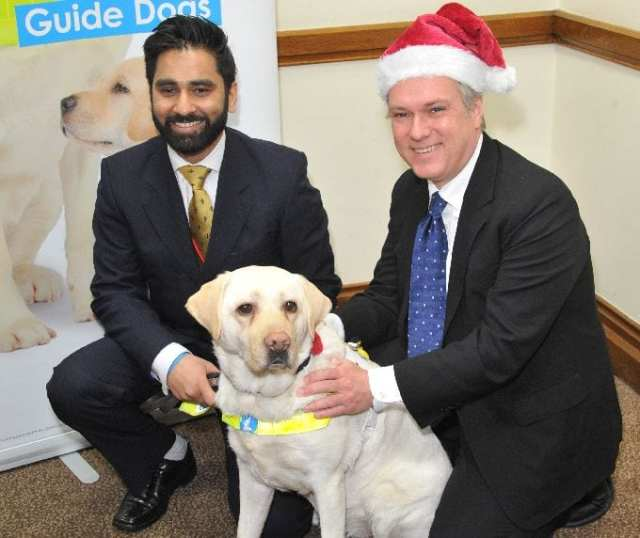 Henry Smith MP with Amit and guide dog Kika