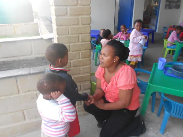 Irene Gaqa greeting children