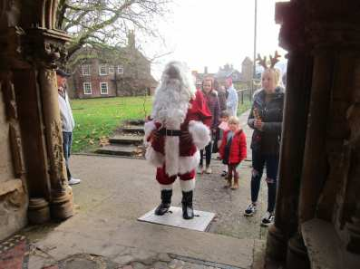 Santa enters Sutterton Parish Church
