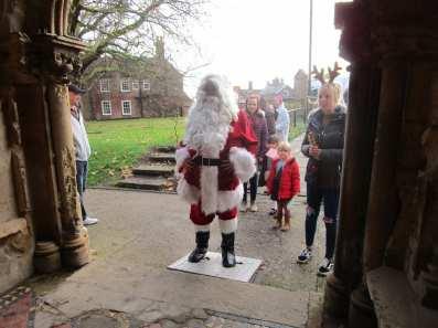 Santa enters Sutterton Parish Church
