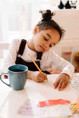 girl draws on white paper