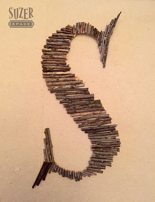 Use sticks, twigs and a cereal box to make a personal wall art initial letter