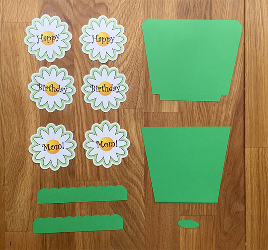 Pieces to make daisy with flowerpot birthday card