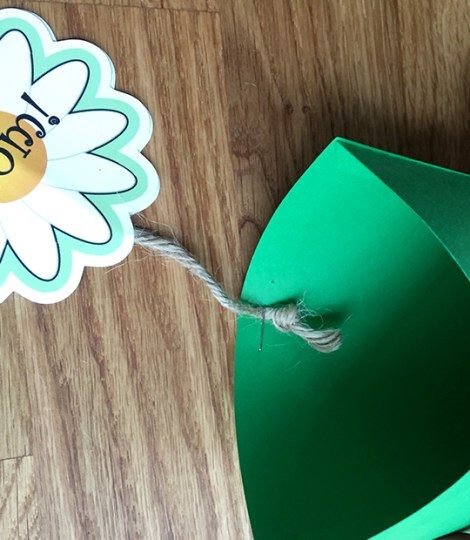 Staple the flowers to the flowerpot card base