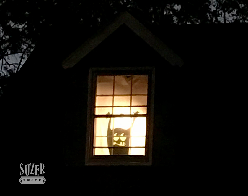 Paper monster silhouettes light up the upstairs window of my house for Halloween | suzerspace.com