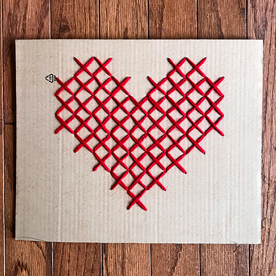 Create oversize artwork by completing a counted cross stitch project on corrugated cardboard   suzerspace.com