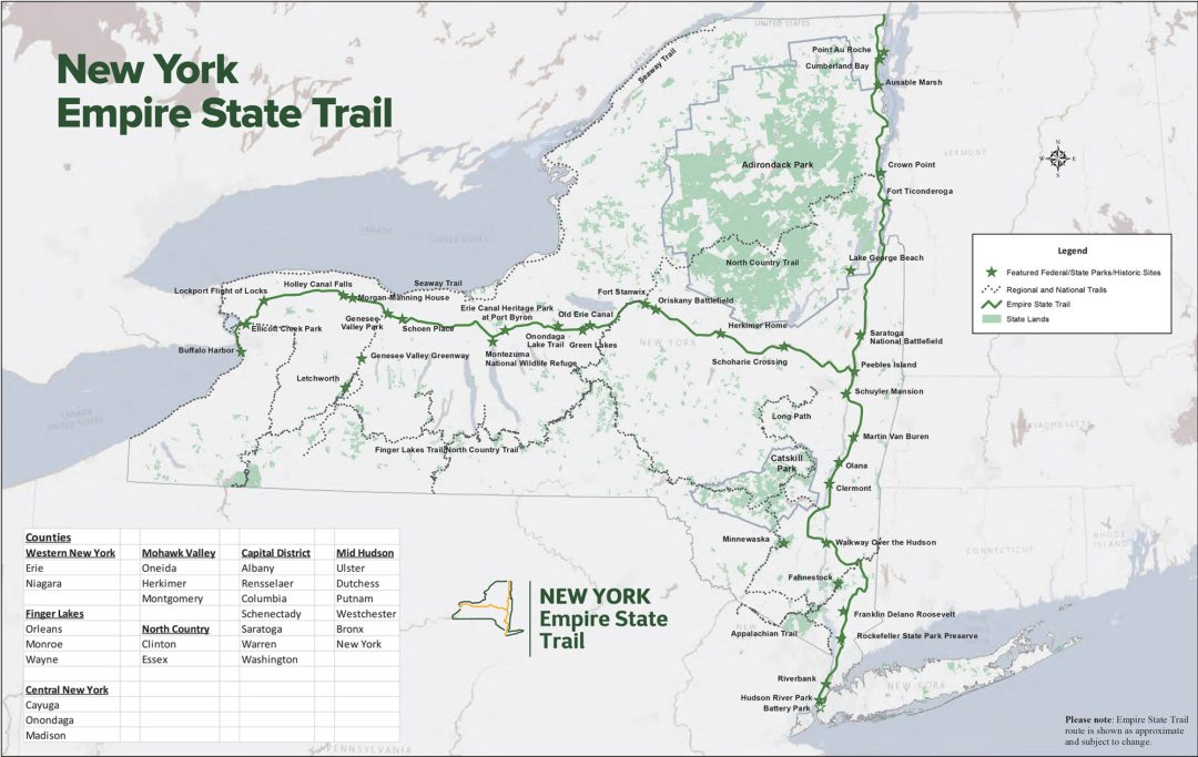 Color map of Empire State Trail through New York State, showing parkland, map key and state routes and boundaries.