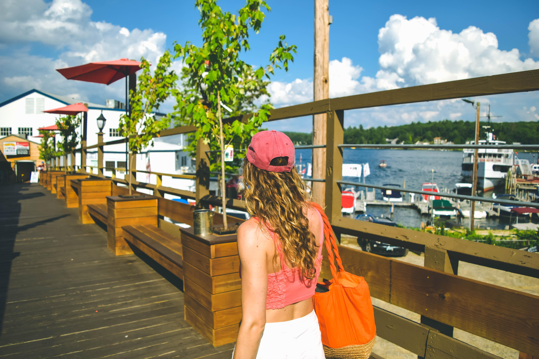 Lake Winnipesaukee_New Hampshire_Travel Guide_What to do_What to See_ice cream_jb scoops_vanilla sugar cone with chocolate sprinkles_summer treats_fashion_winnipesaukee pier_walk_photography_dock