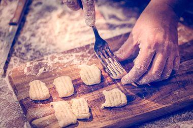 Preparing fresh homemade gnocchi pasta with potatoe dough.