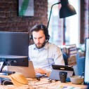 Canva - Selective Focus Photo of Man in Official Shirt Sitting in Office Working on Laptop (1)